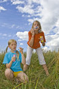 Childrem blowing bubbles Stock Image