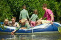 Children and adults float on an inflatable boat Stock Photo