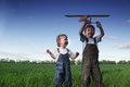 Children with airplan toy outdoors Royalty Free Stock Image