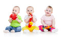 Children babies play musical toys Royalty Free Stock Photo