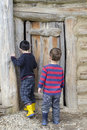 Children at barn door Royalty Free Stock Photo