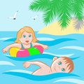 Children bathe in the sea at the resort