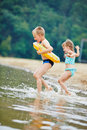 Children bathing in lake in summer two happy together a Royalty Free Stock Photography