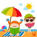 Children at the beach reading a book and eating a slice of watermelon under a beach umbrella.