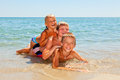 Children on a beach three kids enjoying summer day Royalty Free Stock Photo