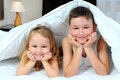 Children in bed brother and sister under blankets on the Royalty Free Stock Photos