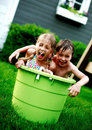 Children in big green bucket Royalty Free Stock Photo