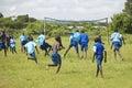 Children in blue uniforms playing soccer at school near tsavo national park kenya africa Royalty Free Stock Photos