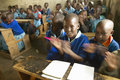 Children in blue uniforms at school behind desk near tsavo national park kenya africa Royalty Free Stock Photos