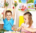 Children boy and girl painting happy Royalty Free Stock Photography