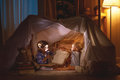 Children boy and girl playing and frighten each other in  tent Royalty Free Stock Photo