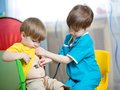Children boys play doctor Royalty Free Stock Photo