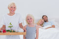 Children bringing breakfast in bed to their parents happy Royalty Free Stock Image