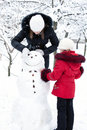 Children build the snowman Stock Image