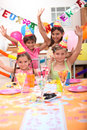 Children celebrating birthdays at a party Stock Photo
