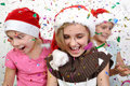 Children celebrating Christmas Royalty Free Stock Photos