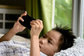 Children and cellphone Royalty Free Stock Photo