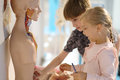Children in the center of entertaining science Royalty Free Stock Photo