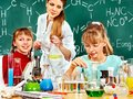 Children in chemistry class and teacher holding flask Stock Photography