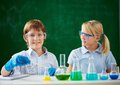 Children at chemistry lesson two schoolchildren working with chemical liquids Royalty Free Stock Image