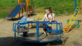 Children on a children s playground in the summer Royalty Free Stock Image