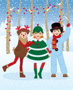 Children in christmas carnival costumes fun outdoors Stock Image