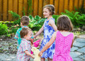 Children in a Circle Playing Ring Around the Rosie Royalty Free Stock Photo