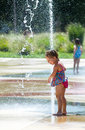 Children and a city fountain laughing little girl plays in the whirlpool compass fountains in st joseph michigan Royalty Free Stock Photography