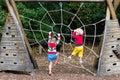 Children climb on school yard playground Royalty Free Stock Photo