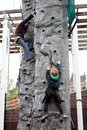 Children climbing groningen april on a pole up Royalty Free Stock Photos