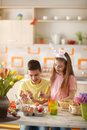 Children coloring Easter eggs Royalty Free Stock Photo