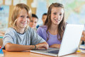 Children in computer science class two smiling students the scinece Royalty Free Stock Images