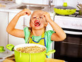 Children cooking at kitchen eating spaghetti Royalty Free Stock Photos
