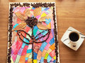 Children craft with coffee beans in shape of flower Royalty Free Stock Image