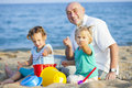 Children with Dad on  beach Royalty Free Stock Photo