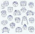 Children doodle faces set of smiley style illustration on a squared paper Royalty Free Stock Images