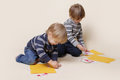 Children drawing arts and crafts with crayons Stock Photos