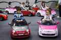 Children driving electric cars at g come giocare in milan italy november drive trade fair dedicated to games toys and on november Stock Photography