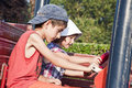 Children driving wooden car Stock Images