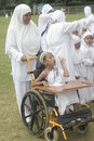 Children early learning disabled children and worship hajj participants include students with disabilities age to use a wheelchair Stock Image