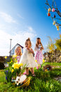 Children on easter egg hunt with bunny an a meadow in spring in the foreground a living is waiting Royalty Free Stock Photography