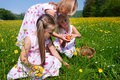 Children on Easter egg hunt with eggs Stock Photo