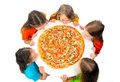 Children eating huge pizza group of little girls with isolated on white Royalty Free Stock Photo