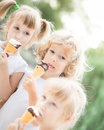 Children eating ice-cream Stock Images
