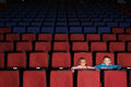 Children in an empty cinema hall two Stock Image