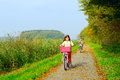 Children enjoying nature on bicycle Royalty Free Stock Images