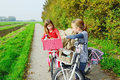Children enjoying nature on bicycle Stock Images