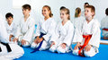 Children enjoying their trainings with coach at karate Royalty Free Stock Photo