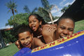 Children Enjoying Themselves In Water Tube Stock Photography