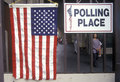 Children at the entrance to a polling place Stock Image